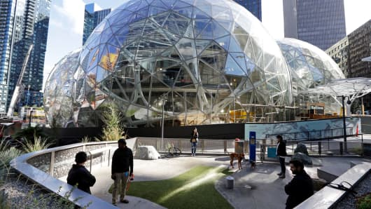 In this photo taken Oct. 11, 2017, large spheres take shape in front of an existing Amazon building and adjacent to a small dog park in Seattle.