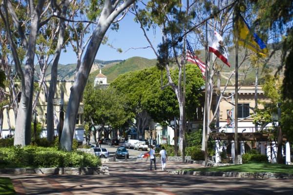 Students walking down Mission Plaza area of coastal town of San Luis Obispo, California.