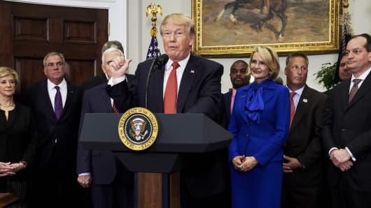 President Donald Trump speaks before signing an executive order on health care in the Roosevelt Room of the White House in Washington, D.C., U.S., on Thursday, Oct. 12, 2017.
