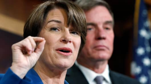 Sen. Amy Klobuchar, D-Minn., left, and Sen. Mark Warner, D-Va., speak about online political ads and preventing foreign interference in U.S. elections, during a news conference, Thursday, Oct. 19, 2017, on Capitol Hill in Washington.