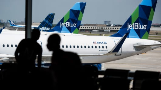 JetBlue planes at a gate at John F. Kennedy International Airport in New York.