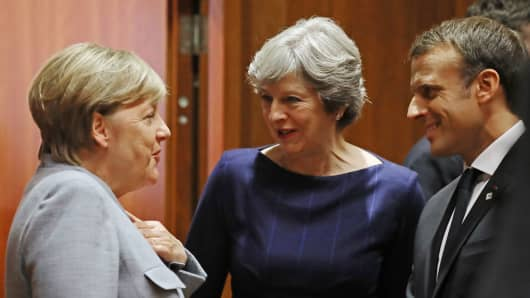 German Chancellor Angela Merkel, British PM Theresa May and French President Emmanuel Macron at Brexit talks on October 19, 2017 in Brussels, Belgium.