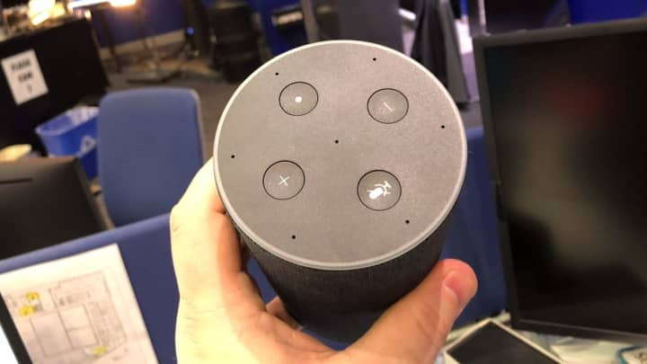 The controls up top are familiar; the small holes are microphones