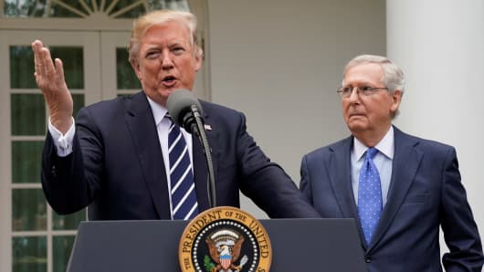 President Donald Trump speaks to the media with U.S. Senate Majority Leader Mitch McConnell at his side in the Rose Garden of the White House in Washington, U.S., October 16, 2017.