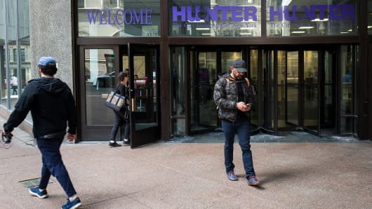 People enter and exit at an entrance to Hunter College of The City University of New York, April 10, 2017 in New York City.