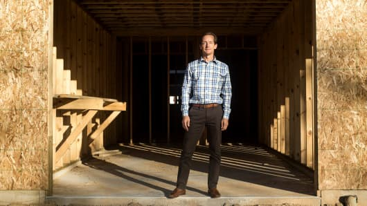 Chris Gutek, who invests in high-interest rate loans for new and renovated properties, at the site of a development in Grand Rapids Township, Mich., Oct. 18, 2017.