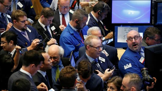 Traders gather for the IPO of Singapore-based Sea Limited on the floor of the New York Stock Exchange (NYSE) in New York, U.S., October 20, 2017.