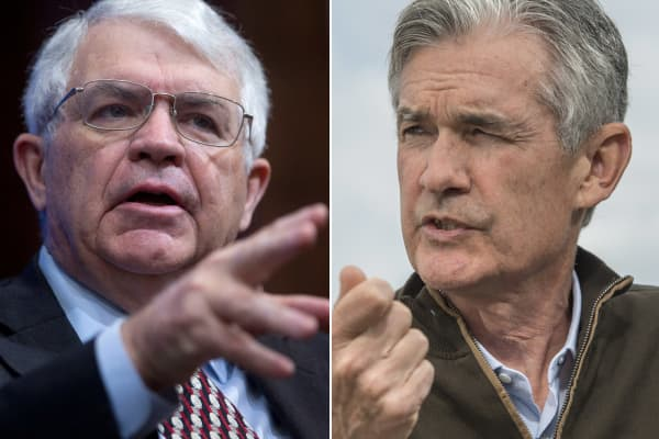John Taylor, of professor of economics at Stanford University (l), and Jerome Powell, governor of the Federal Reserve.
