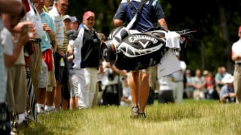 Phil Mickelson's caddie Jim 'Bones' MacKay carries their Callaway bag during the second round of the 109th U.S. Open on the Black Course at Bethpage State Park on June 19, 2009 in Farmingdale, New York.(