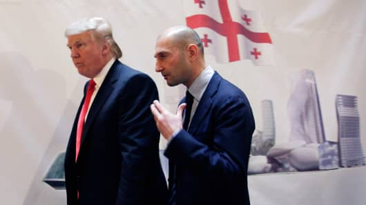 Real estate developer Donald Trump, left, and George Ramishvili, Chairman of Silk Road Group, talk following a news conference in New York, Thursday, March 10, 2011.