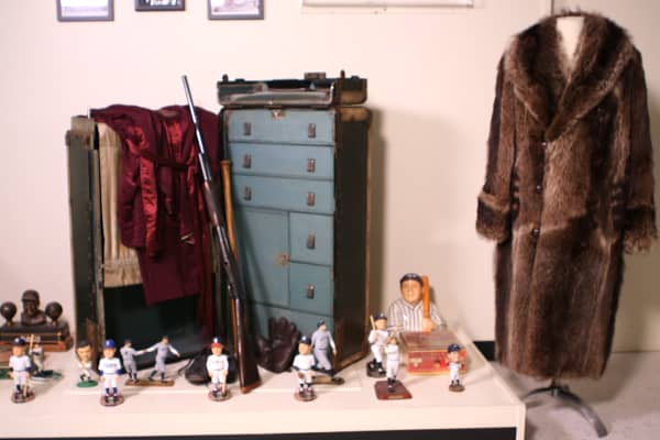 Babe Ruth's fur coat and shot gun.
