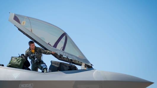 Air Force Capt. Michael Slotten, a 61st Fighter Squadron F-35 student pilot, climbs into an F-35 Lighting II at Luke Air Force Base, Ariz., July 7, 2017.