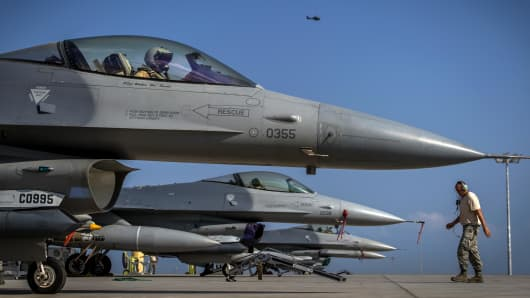 F-16 Fighting Falcon pilots prepare for takeoff for training exercise at Camp Lemonnier, Djibouti.