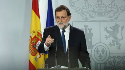 Spanish Prime Minister Mariano Rajoy gives the word to a journalist during a press conference after an extraordinary cabinet meeting at Moncloa Palace on October 21, 2017 in Madrid, Spain.