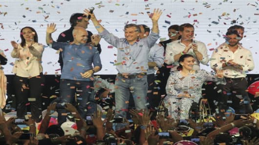 Argentina's President Mauricio Macri (C) and other leading political figures celebrate in Buenos Aires, Argentina, on October 23, 2017, after nationwide legislative elections.
