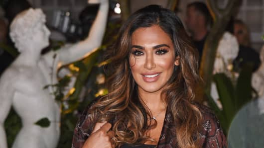 Huda Kattan at the Burberry show during London Fashion Week SS17.