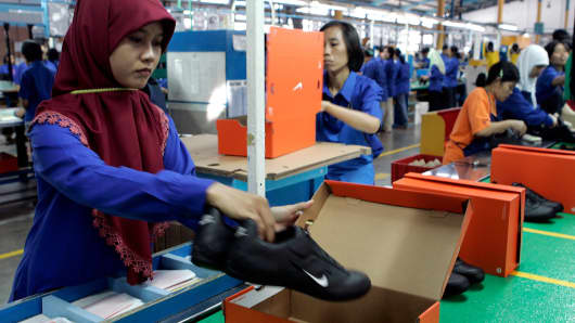 Workers pack shoes at a Nike factory in Tangerang in West Java province.