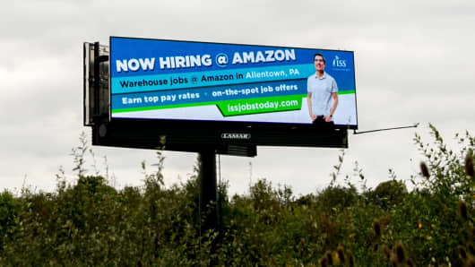 A sign off of Interstate 78 advertises for job openings at an Amazon fulfillment center, in Bethlehem, Pa., Oct. 12, 2017.