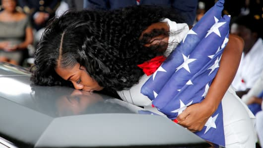 2017Myeshia Johnson, wife of U.S. Army Sergeant La David Johnson, who was among four special forces soldiers killed in Niger, kisses his coffin at a graveside service in Hollywood, Florida.