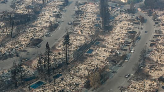 A firestorm that began in Napa Valley's Calistoga destroys more than 1,000 homes and businesses in just the northwestern Coffey Park neighborhood as viewed in this aerial photo taken on October 12, 2017, in Santa Rosa, California. State officials are calling the Tubbs Fire the most destructive wildfire in history.