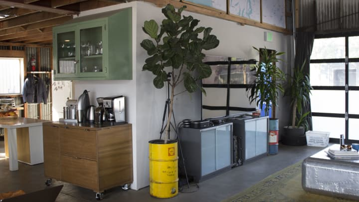 Oil barrels are used as planters in the offices of EV charging start-up, Volta, in San Francisco.