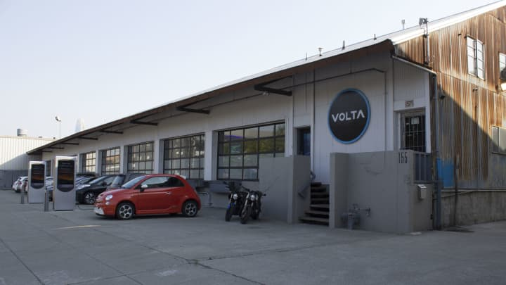 Employees' electric cars and motorcycles parked at Volta Charging in San Francisco.