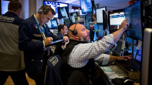 Dow hits 26000 points but loses early gains