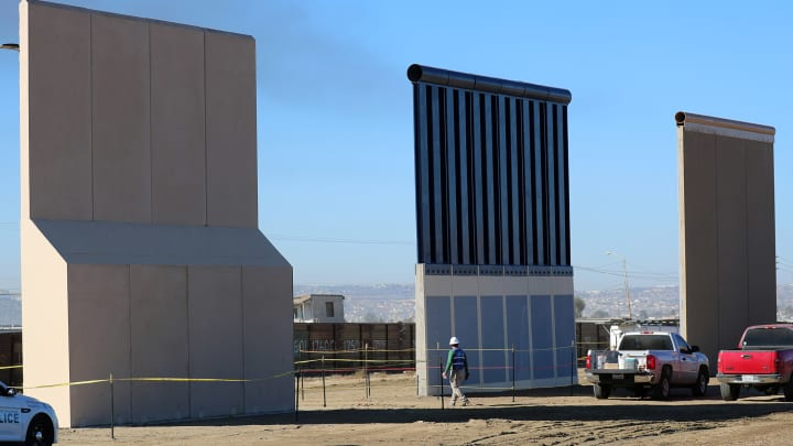 Three of U.S. President Donald Trump's eight border wall prototypes are shown near completion along U.S.- Mexico border in San Diego, California, U.S., October 23, 2017.