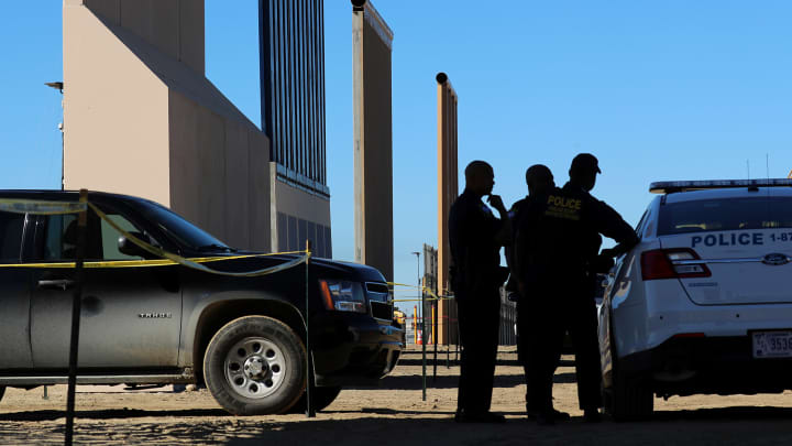 Federal agents stand watch over U.S. President Donald Trump's eight border wall prototypes as they near completion along U.S.- Mexico border near San Diego, California, U.S., October 23, 2017.