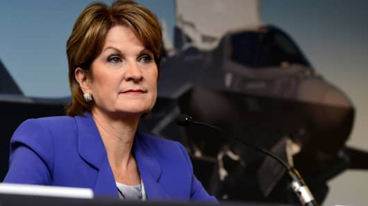 Marillyn Hewson, the Chairman, President and Chief Executive Officer of Lockheed Martin.