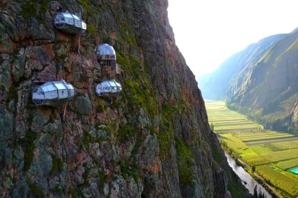 Sleep in glass pods suspended 1,200 ft. up the side of mountain in Peru's Sacred Valley