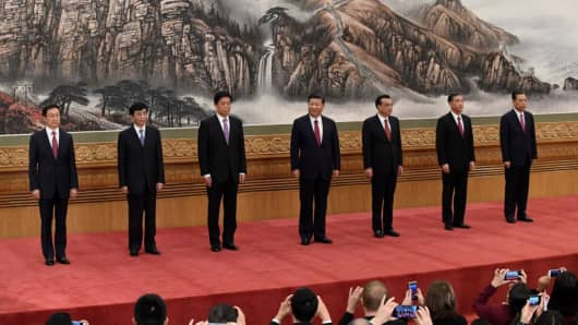 The Communist Party of China's new Politburo Standing Committee, the nation's top decision-making body (L-R) Han Zheng, Wang Huning, Li Zhanshu, Chinese President Xi Jinping, Premier Li Keqiang, Wang Yang, Zhao Leji meet the press at the Great Hall of the People in Beijing on October 25, 2017.