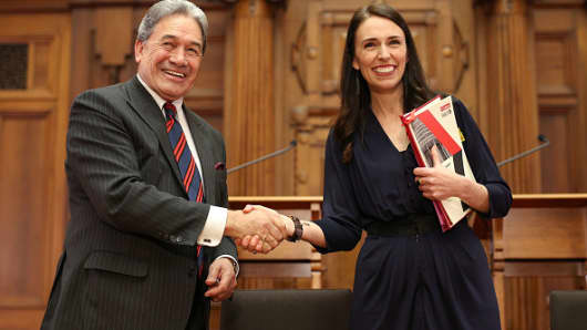 Prime Minister-designate Jacinda Ardern and NZ First leader Winston Peters shake hands during a coalition agreement signing.