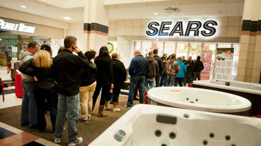 Shoppers line up next to hot tubs as they wait for a Sears Holdings Corp. store to open ahead of Black Friday in Peoria, Illinois.