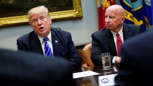 President Donald Trump, flanked by U.S. Representative Kevin Brady (R-TX) meets with members of the House Ways and Means Committee about proposed changes to the U.S. tax code at the White House in Washington, September 26, 2017.