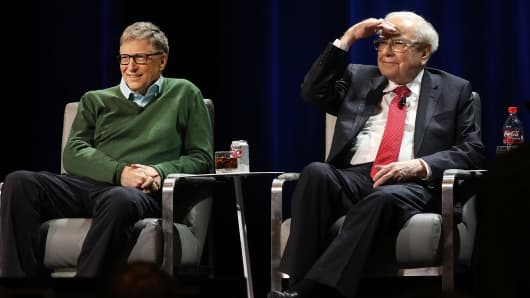 Billionaires Bill Gates and Warren Buffett speak with journalist Charlie Rose at an event organized by Columbia Business School on Jan. 27, 2017, in New York.