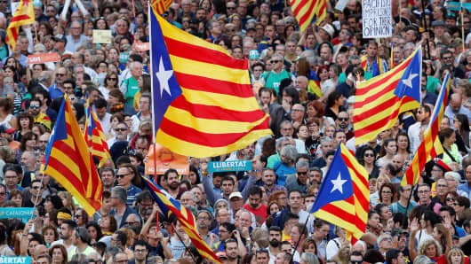 People wave Catalan separatist flags during a demonstration organised by Catalan pro-independence movements ANC (Catalan National Assembly) and Omnium Cutural, following the imprisonment of their two leaders Jordi Sanchez and Jordi Cuixart, in Barcelona, Spain, October 21, 2017.