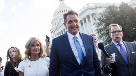 Sen. Jeff Flake (R-AZ) and his wife Cheryl Flake leave the U.S. Capitol as they are trailed by reporters, October 24, 2017 in Washington, DC.