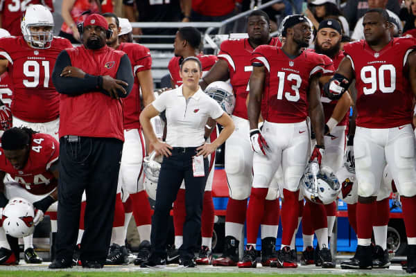 Jen Welter of the Arizona Cardinals watches from the sidelines during the pre-season NFL game against the Kansas City Chiefs at the University of Phoenix Stadium on August 15, 2015.