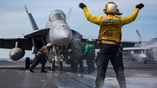 U.S. Navy sailors conduct flight operations aboard the Nimitz-class aircraft carrier USS Carl Vinson in the western Pacific Ocean in this Navy handout photo taken May 2, 2017.