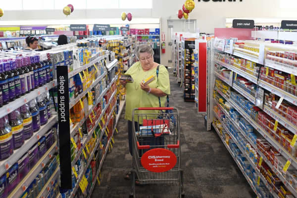 A woman shops at the new CVS Pharmacy on May 30, 2017 in Parker, Colorado.