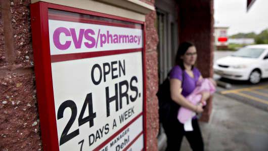 A customer exits a CVS Health Corp. pharmacy in La Vista, Nebraska.