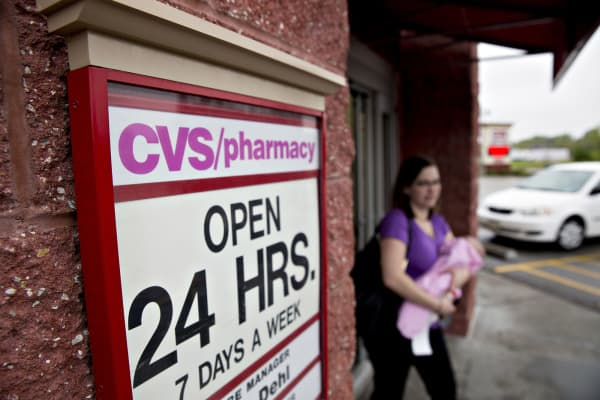 A customer exits a CVS Health Corp. pharmacy in La Vista, Nebraska.