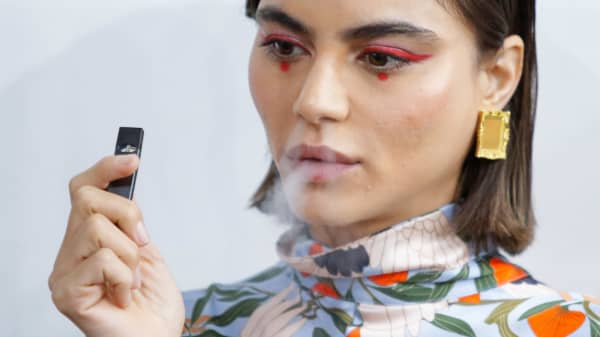 A model smokes a Juul e-cig during New York Fashion Week.