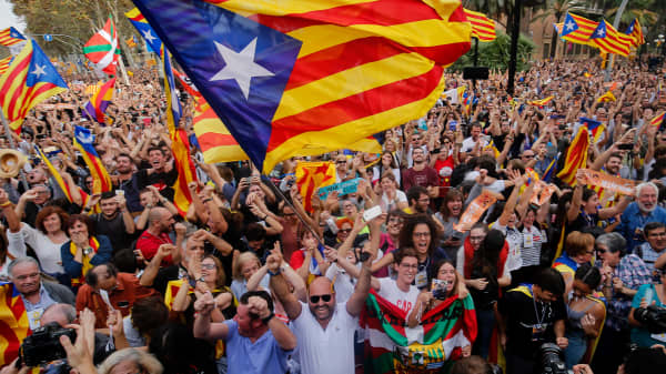 Catalonia's parliament voted to declare independence from Spain and proclaim a republic, just as Madrid is poised to impose direct rule on the region to stop it in its tracks.