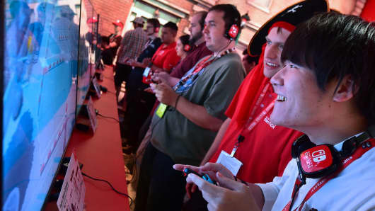 Gaming fans play 'Super Mario Odyssey' with Nintendo Switch gaming console at E3 2017 last June.