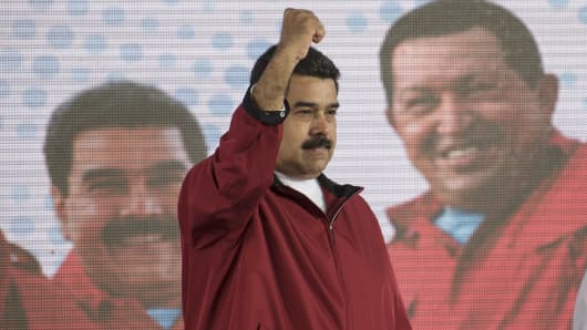 Nicolas Maduro, president of Venezuela, gestures to the audience during a swearing in ceremony for the new board of directors of Petroleos de Venezuela SA (PDVSA).