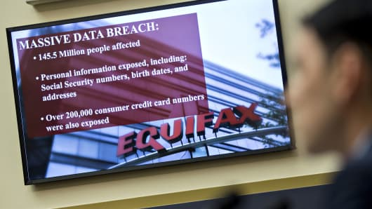 An Equifax Inc. slide is displayed on a monitor in October 2017.