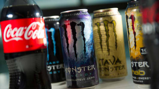 Cans of Monster Beverage Corp. energy drinks and bottles of Coca-Cola Co. sodas.