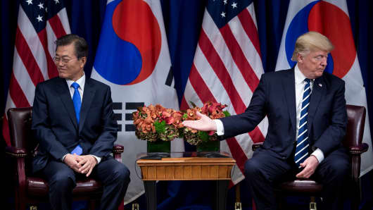 President Donald Trump gestures to South Korean President Moon Jae-in during the 72nd United Nations General Assembly on September 21, 2017.